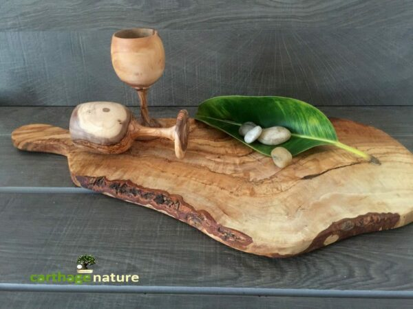 olive wood chopping board with hand